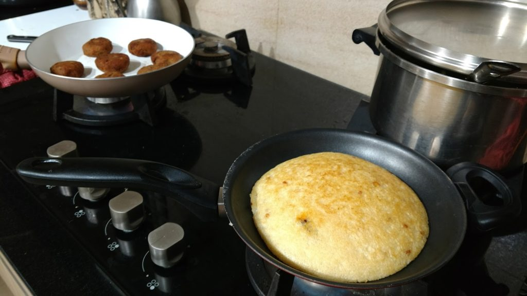 Idli (rice based dish) and lentil patties provide vegetarian options for guests.