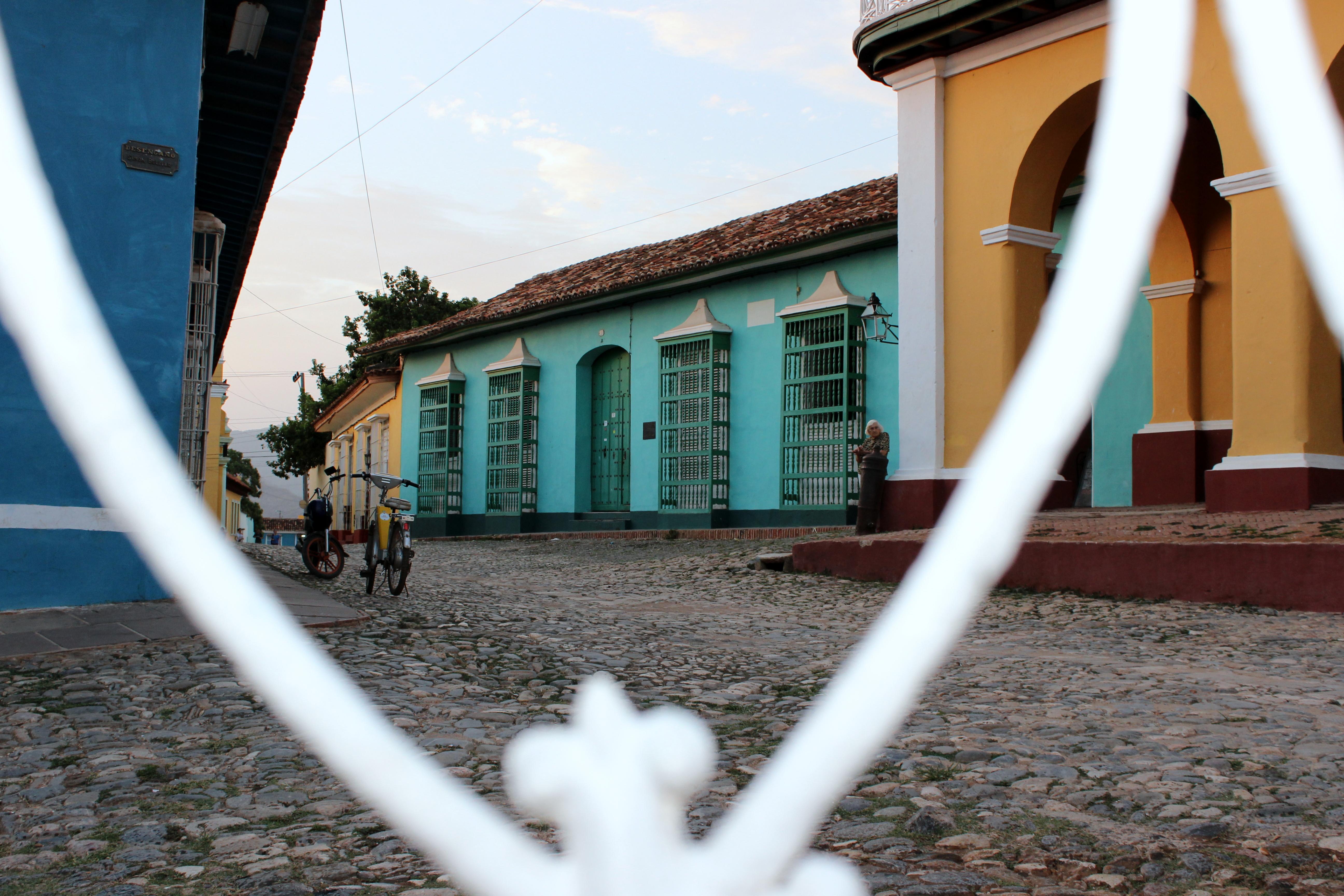 Trinidad at dusk thru fence