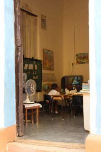 An image of elementary school children watch T.V. in a classroom in Trinidad, Cuba.