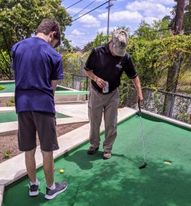 Dad and son play miniature golf at Cool Crest. Photo credit: Iris Gonzalez