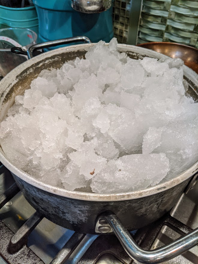 Boiling snow for water. Photo credit: Iris Gonzalez