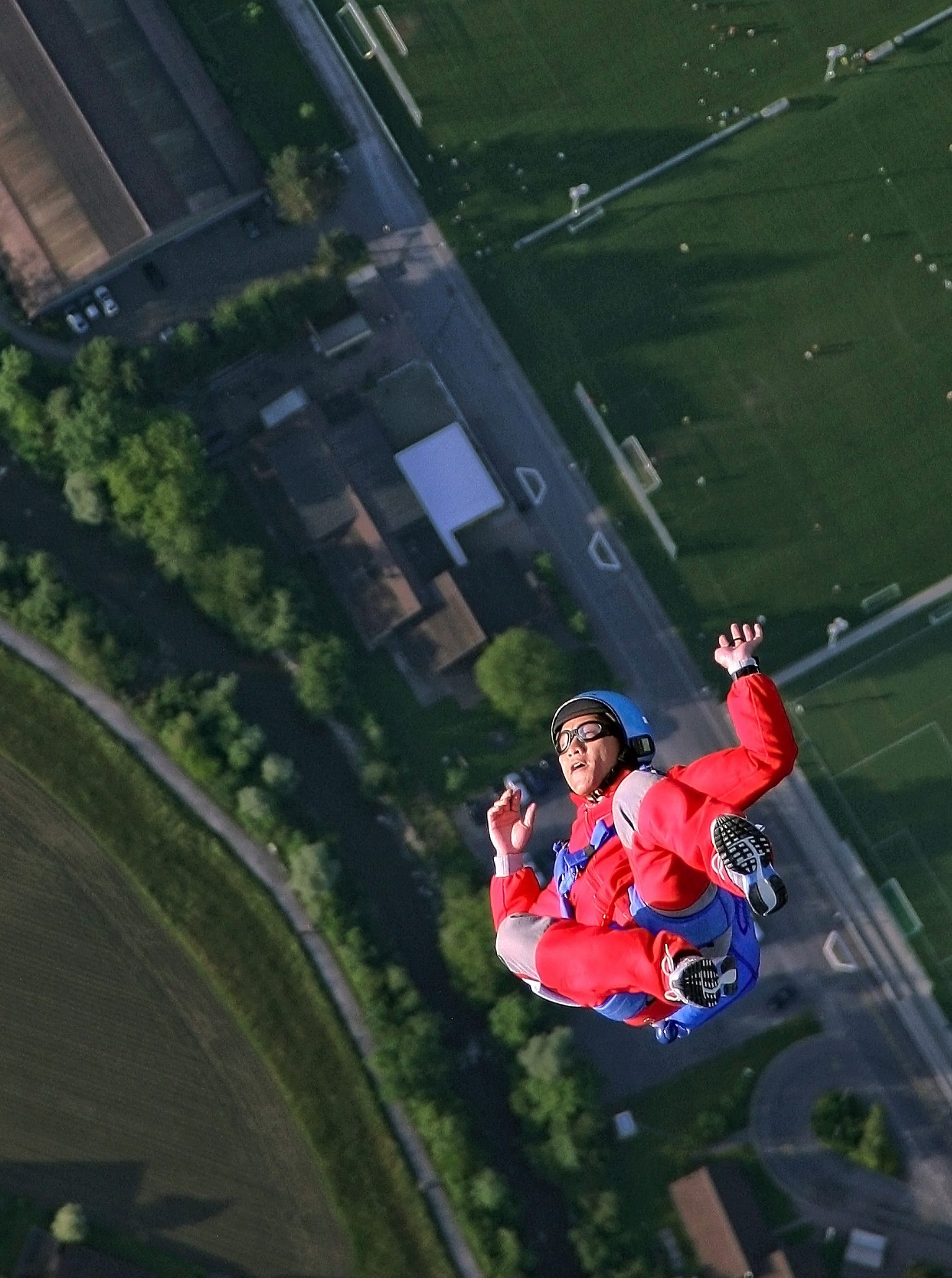 A man jumps out of a plane with a parachute. Photo by Ricardo Gomez on Unsplash.